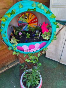 Picture of garden planter with colourful decorations