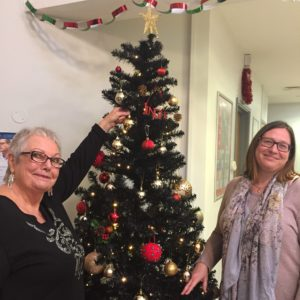 Picture of Brunswick Hub staff with Christmas tree